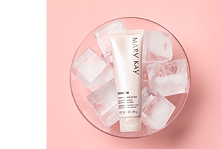A tube of TimeWise Moisture Renewing Gel Mask is shown being chilled in a bowl of ice cubes.